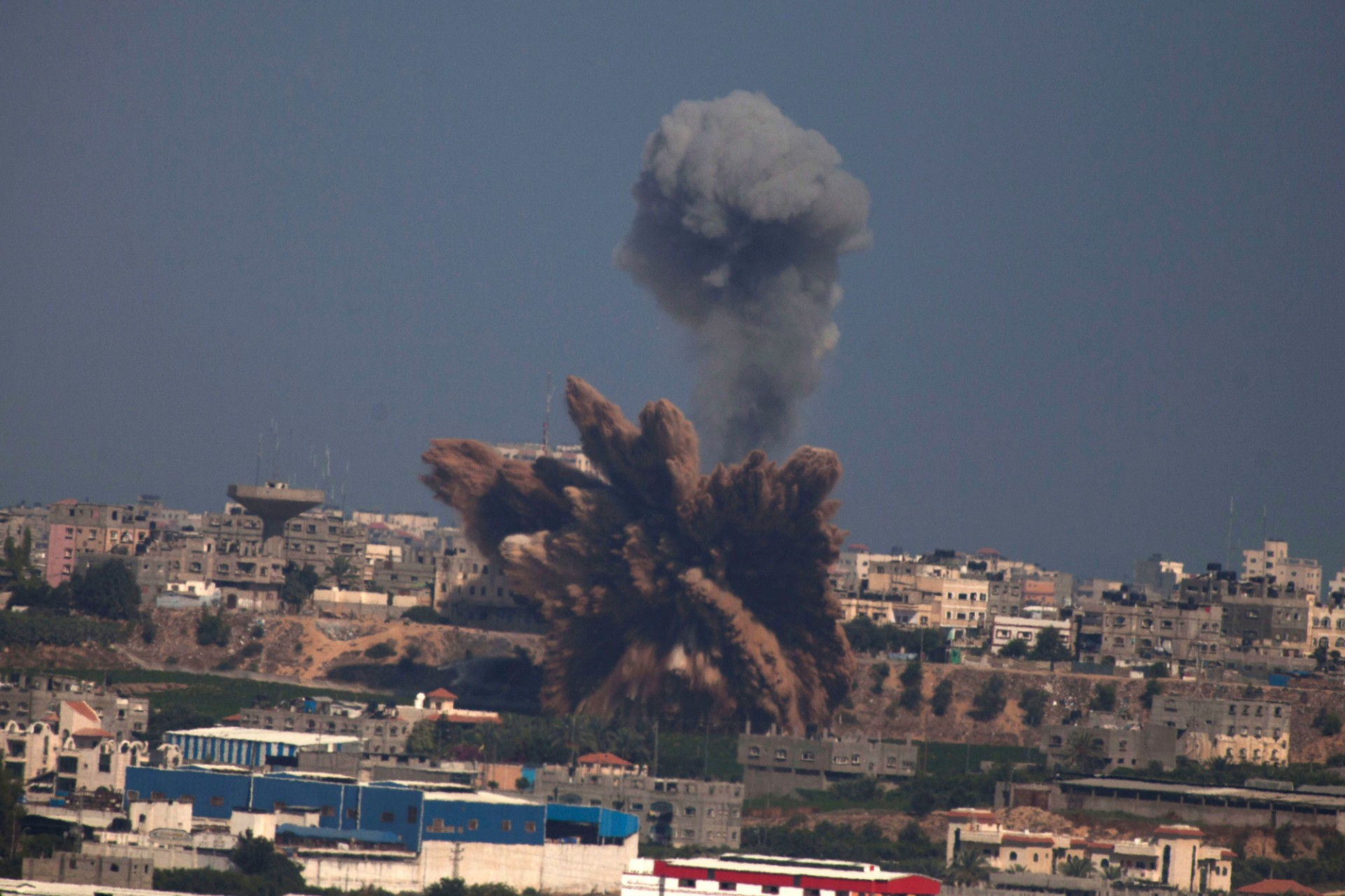 A plume of smoke rises over Gaza following an Israel Air Force bombing, on July 9, 2014.