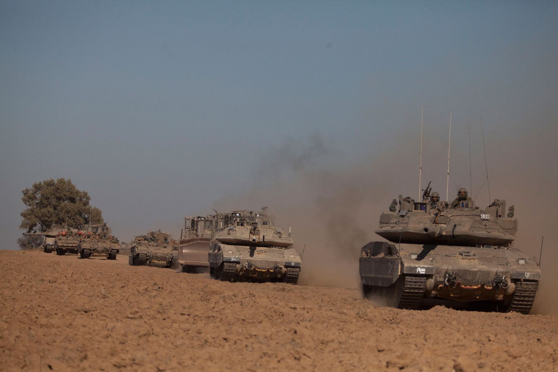 Israeli tanks seen moving along the border with Gaza on July 17, 2014 on Israel's border with the Gaza Strip.
