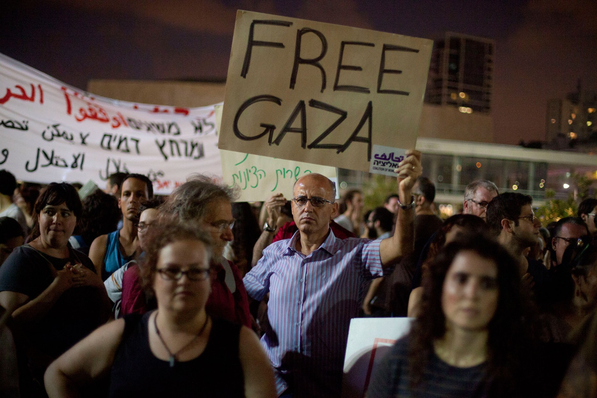 Israelis take part in a protest against Israel's military operation in the Gaza Strip on July 19, 2014 in Tel Aviv, Israel.