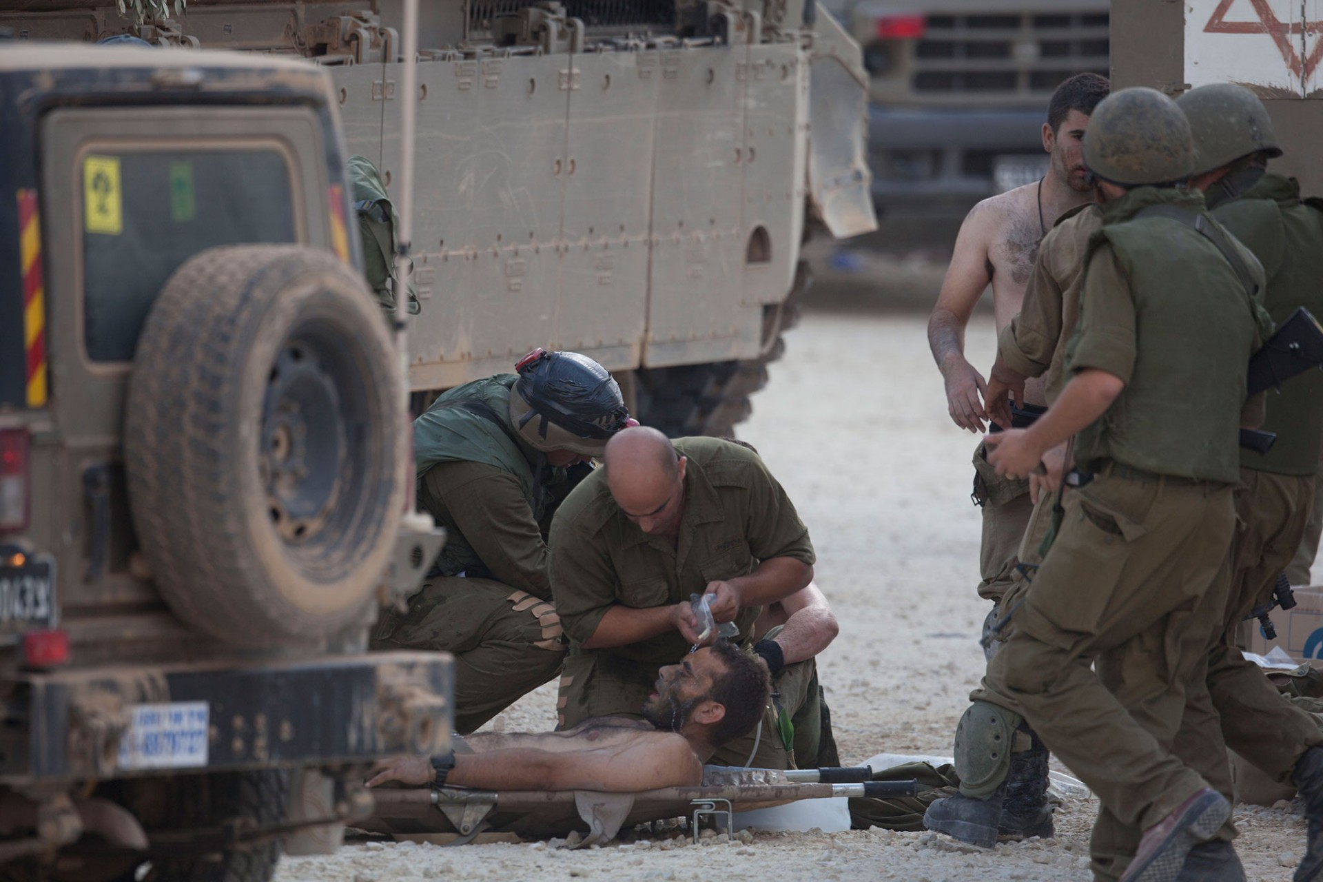 Israeli soldiers give medical care to soldiers who where wounded during an offensive in Gaza on July 20, 2014 at the Israeli-Gaza border.