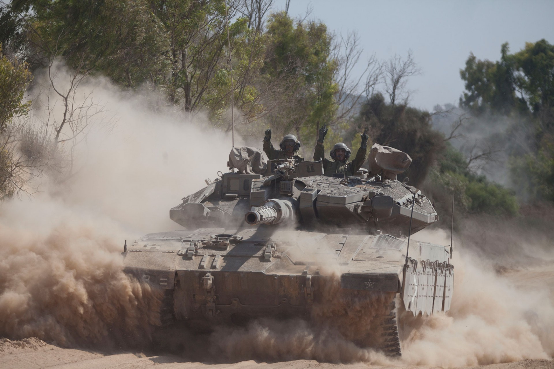 An Israeli tank moves along the border on July 20, 2014 on the Israel/Gaza Strip border.
