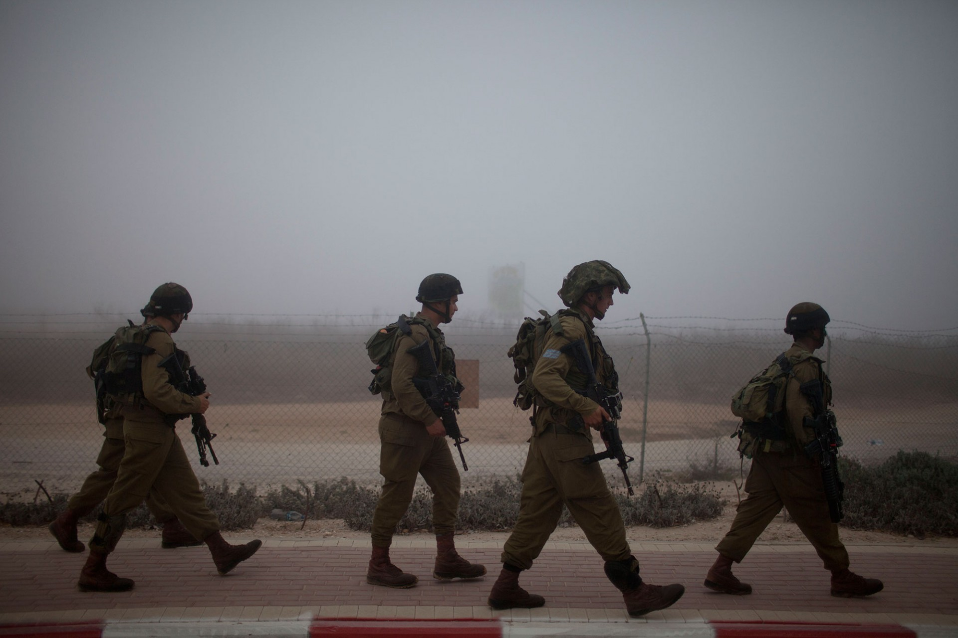 Israeli soldiers patrol next to a Kibutz on July 24, 2014 on Israel's border with the Gaza Strip.